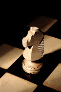Close-up White knight chess piece on a chess board