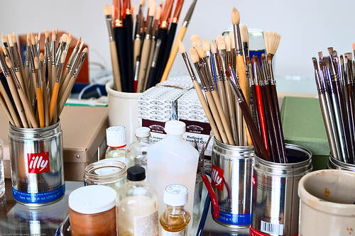 Artist's Paintbrushes and colored pencils