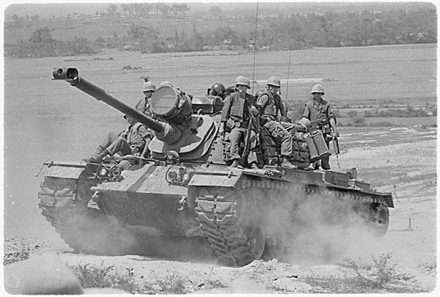 Marines of E Company, 2nd Battalion, 3rd Marines, riding on an M48A3 tank, Vietnam, 1966.