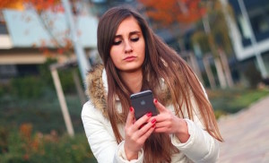 Girl on Phone-Invest in Mobile Marketing-min