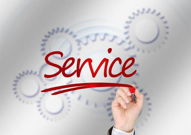 "Freight Forwarding Services: The hand of a person who knows what freight forwarding is and how small businesses use it writing the word ""service"" using a red marker"