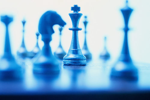 Blue chess pieces on a chess board