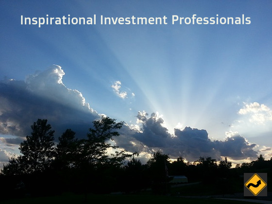Inspirational Investment Professionals Landscape with blue sky and the rays of the sun coming up from behind the trees